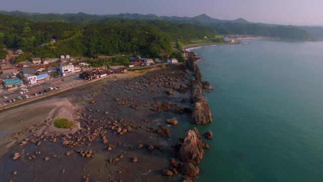 aerial footage at hashikuiiwa rocks in kushimoto city - satoyama scenery stock videos & royalty-free footage
