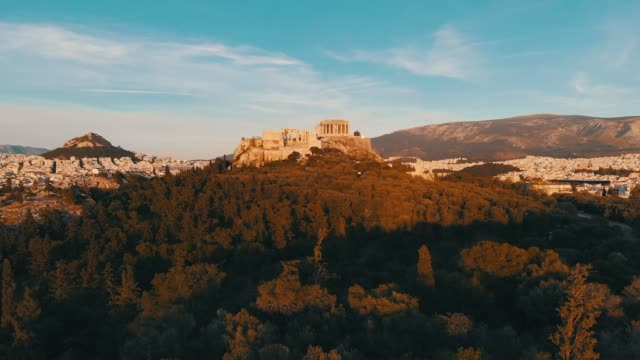 aerial footage - athens - greece - close view of the acropolis from a hill full of trees - athens greece stock videos & royalty-free footage