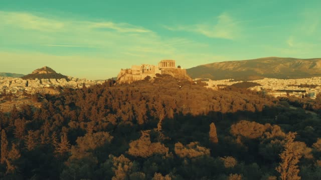 Aerial footage - Athens - Greece - close view of the Acropolis from a hill full of trees