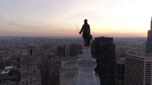 aerial footage circling the william penn statue on top of philadelphia city hall - philadelphia pennsylvania stock videos & royalty-free footage