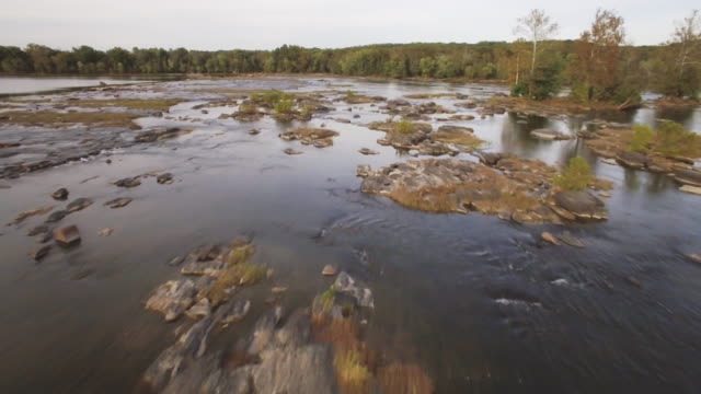 aerial footage crossing the potomac river from virginia to maryland - river potomac stock videos & royalty-free footage