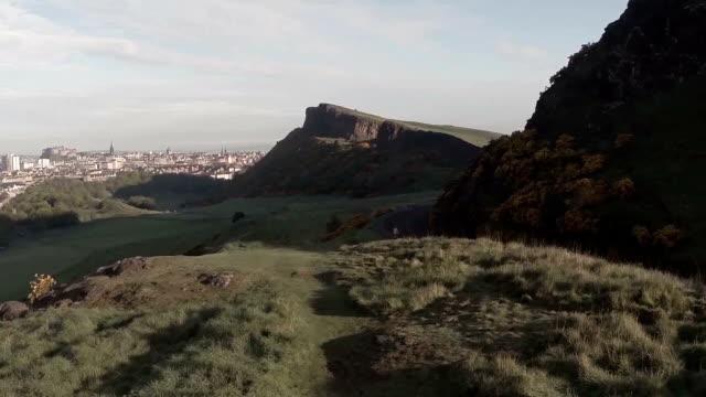 Aerial footage flying over Arthurs Seat in Edinburgh