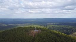 Aerial footage flying over the fire tower on Blue Mountain, near Newbury, central Victoria, Australia.