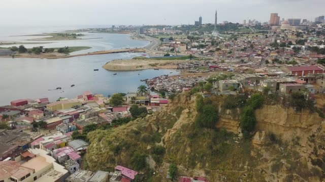 vidéos et rushes de aerial footage from luanda city, capital of angola - bidonville