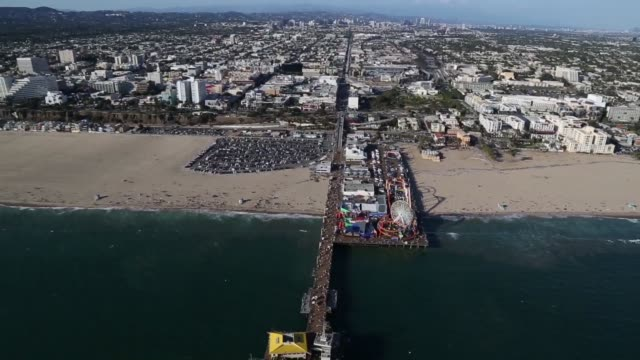 aerial footage hovers above santa monica pier on a beautiful clear summer day in california on july 10th 2015 shots various aerial shots of the... - santa monica stock videos & royalty-free footage
