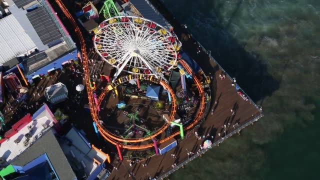 aerial footage hovers above santa monica pier on a beautiful clear summer day in california on july 10th 2015 shots various aerial shots of the... - santa monica pier stock videos & royalty-free footage