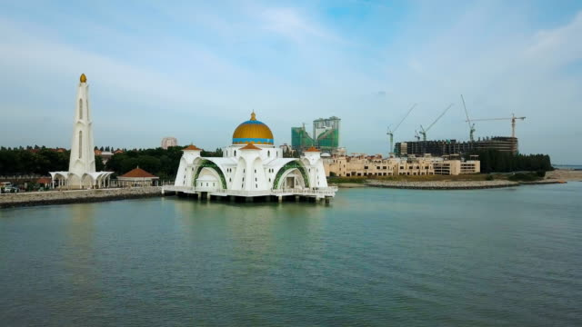 aerial footage - mosque located on the man-made, the melaka straits mosque, melaka, malasia - malacca stock videos and b-roll footage