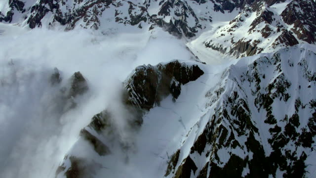 Aerial Footage New Zealand Alps mountain ridge shrouded in cloud