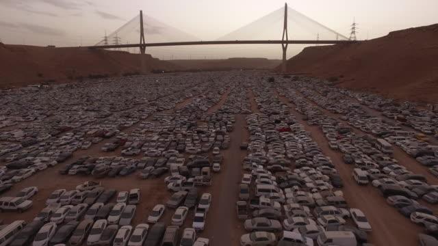 aerial footage of a car junkyard, riyadh, saudi arabia - riyadh stock videos & royalty-free footage