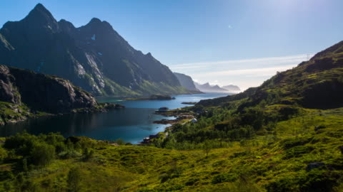 aerial footage of a fjord at the lofoten islands in norway - mountain stock videos & royalty-free footage