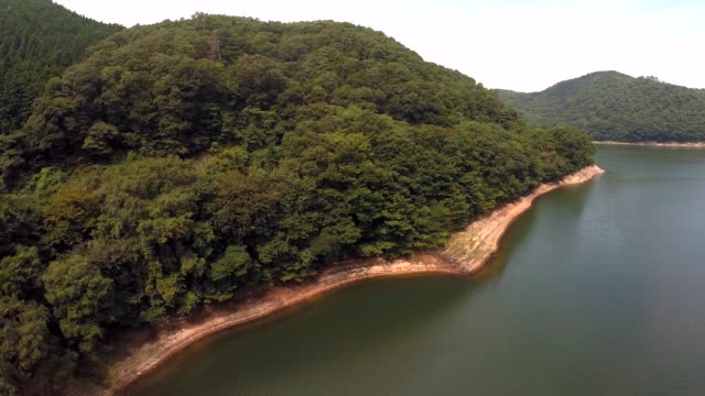 aerial footage of a man made lake - satoyama scenery stock videos & royalty-free footage