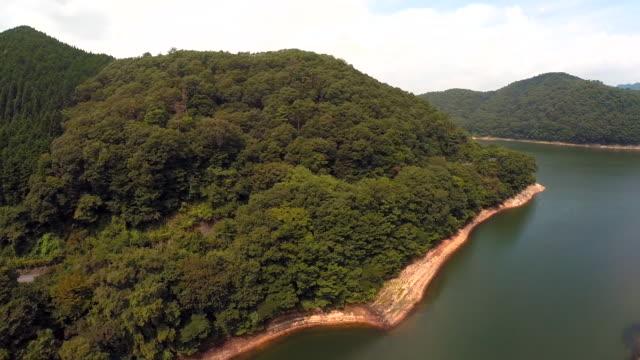 aerial footage of a man made lake - satoyama scenery stock videos & royalty-free footage