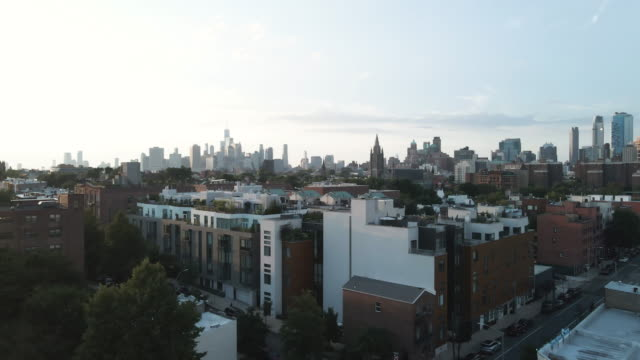 aerial footage of a rooftop pool in brooklyn, new york city - brooklyn new york stock videos & royalty-free footage