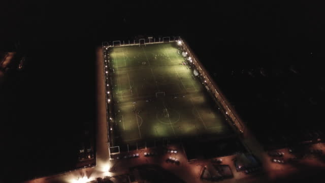 aerial footage of a soccer field on a brooklyn pier in the east river. - football pitch stock videos and b-roll footage