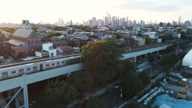 aerial footage of a subway train passing through brooklyn, new york city - brooklyn new york stock videos & royalty-free footage