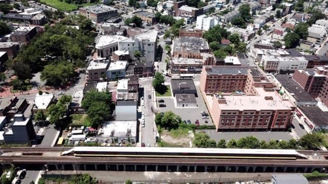 aerial footage of a train rail in stapleton of staten island new york - stapleton stock videos & royalty-free footage