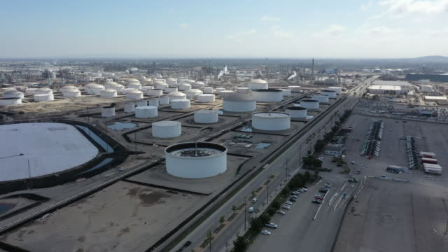 aerial footage of aboveground storage tanks for oil and petroleum products at the marathon los angeles refinery on tuesday, april 21, 2020 in carson,... - pipeline stock-videos und b-roll-filmmaterial