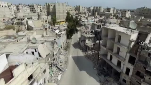 aerial footage of aleppo syria which has seen heavy destruction due to air strikes - syrien stock-videos und b-roll-filmmaterial