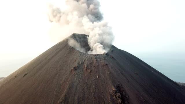 aerial footage of anak krakatau volcano erupting ash in indonesia - krater stock-videos und b-roll-filmmaterial