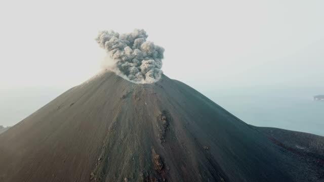 aerial footage of anak krakatau volcano spewing ash and lava in indonesia - erupting stock videos & royalty-free footage