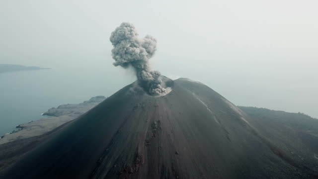 aerial footage of anak krakatau volcano spewing ash and lava in indonesia - indonesia islands stock videos & royalty-free footage