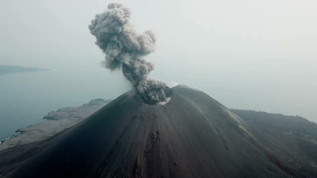 aerial footage of anak krakatau volcano spewing ash and lava in indonesia - indonesia stock videos & royalty-free footage