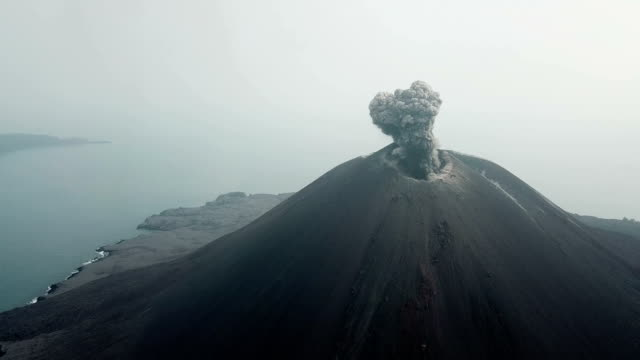 aerial footage of anak krakatau volcano spewing ash and lava in indonesia - indonesia volcano stock videos & royalty-free footage