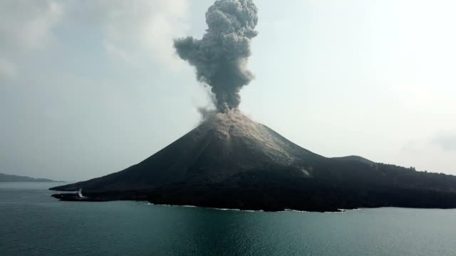 aerial footage of anak krakatau volcano spewing ash and lava in indonesia - erupting stock videos & royalty-free footage
