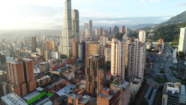 Aerial footage of buildings and towers in city on sunny day, Bogota, Colombia