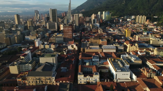 aerial footage of buildings in city on sunny day, bogota, colombia - bogota stock videos & royalty-free footage