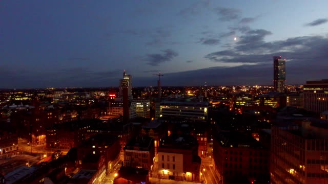 aerial footage of cityscape in manchester, uk at night - manchester england stock videos & royalty-free footage