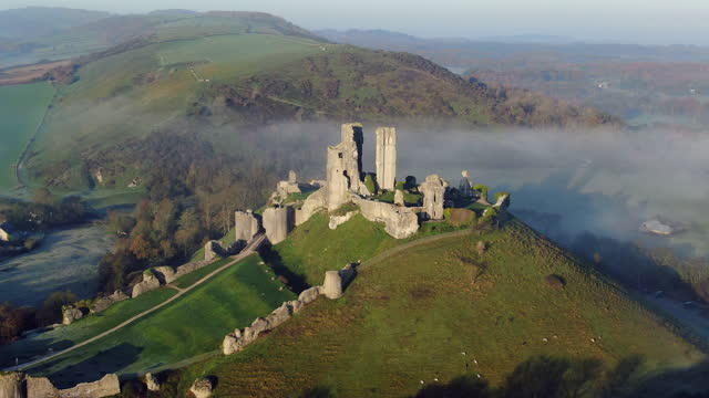 aerial footage of corfe castle, corfe, isle of purbeck, dorset, england - national trust video stock e b–roll