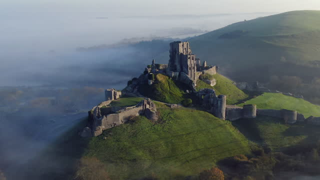 aerial footage of corfe castle, corfe, isle of purbeck, dorset, england - image stock videos & royalty-free footage
