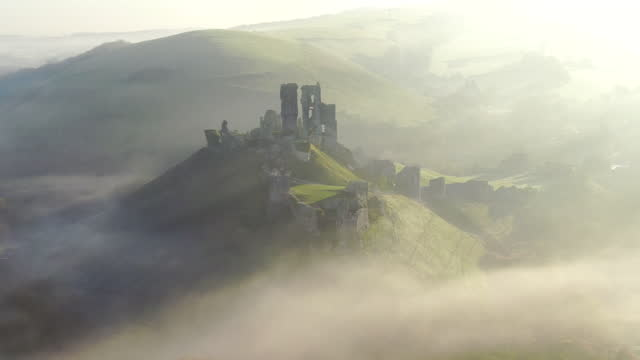 aerial footage of corfe castle, corfe, isle of purbeck, dorset, england - old ruin stock videos & royalty-free footage