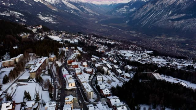aerial footage of crans montana village in the alps, switzerland - 気まぐれな空点の映像素材/bロール