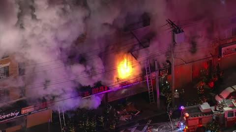 vidéos et rushes de aerial footage of fire trucks responding to a three alarm fire in the bronx, new york. - segment monté