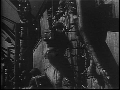 aerial footage of fleet of ships at sea / sailors climb over side of ship and onto landing barge / crew climb down cargo nets / landing barges move... - sea channel stock videos and b-roll footage