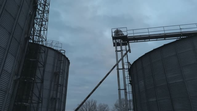 aerial footage of flying over an old abandoned flour mill - flour mill stock videos & royalty-free footage