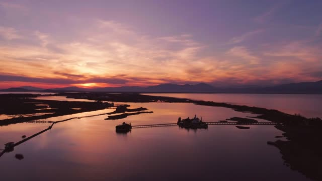 Aerial footage of lake and lagoon Vistonida in Xanthi and Porto Lagos, in Thrace at dusk