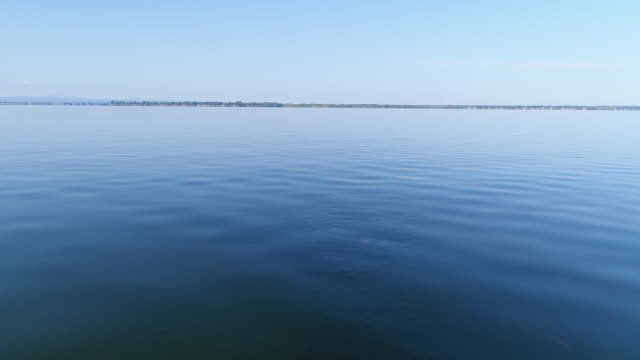 Aerial footage of Lake Champain on a clalm summer morning