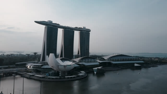 aerial footage of marina bay singapore - marina bay sands stock videos and b-roll footage