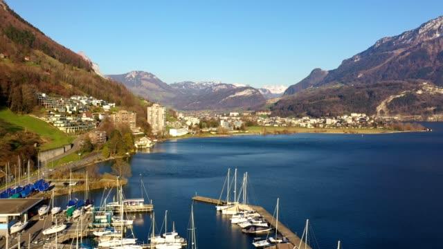 aerial footage of marina in brunnen, canton schwyz in switzerland - lake lucerne stock videos & royalty-free footage