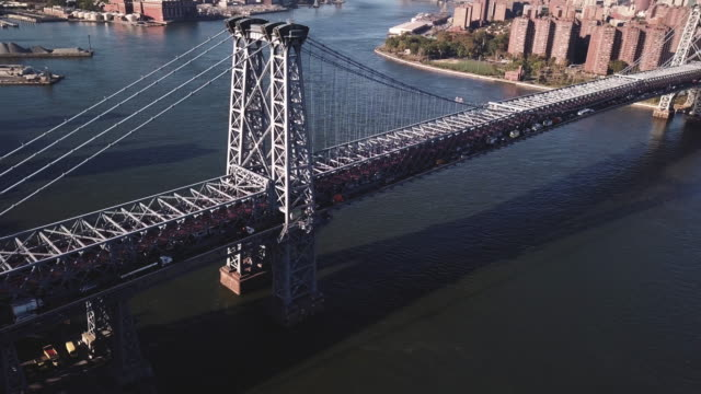 aerial footage of new york city's williamsburg bridge from the brooklyn side. - williamsburg bridge stock videos & royalty-free footage