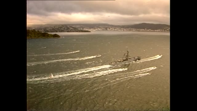 aerial footage of nuclear ship uss texas arriving in wellington harbour - 1983 stock videos & royalty-free footage
