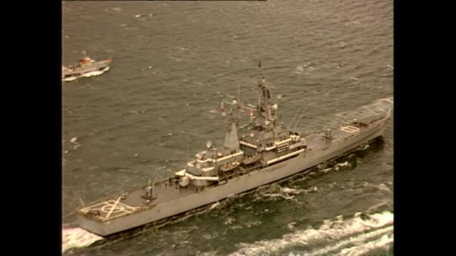aerial footage of nuclear ship uss texas arriving in wellington harbour. - us navy stock videos & royalty-free footage