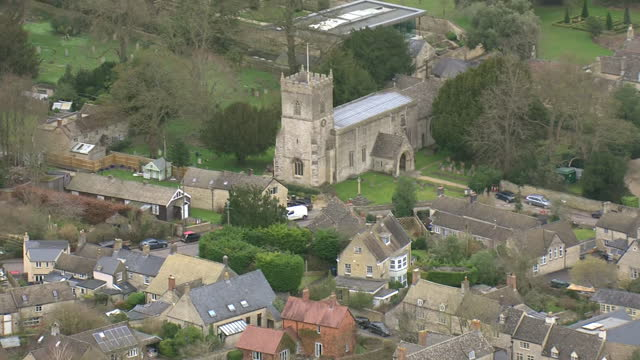 aerial footage of oxfordshire villages and surrounding farmland on 23 febraury 2021 in oxfordshire, united kingdom - village stock videos & royalty-free footage