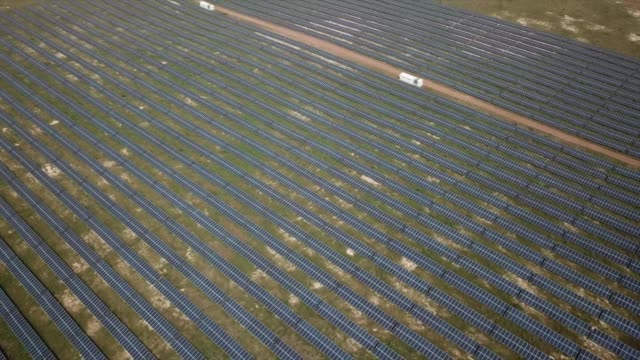 aerial footage of photovoltaic solar panels at the senergy santhiou mekhe pv solar plant in thies, senegal, on monday, oct. 16 photographer: xaume... - senegal stock videos & royalty-free footage