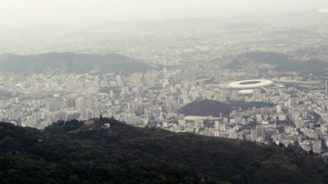 Aerial footage of Rio, including soccer arena and mountains