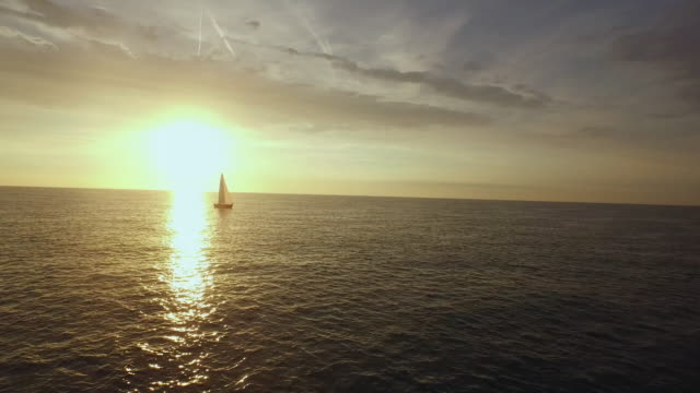 aerial footage of sailboat during sunset. - sail stock videos & royalty-free footage