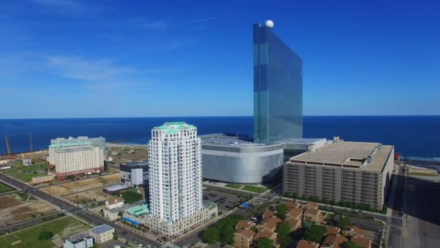 Aerial footage of several vignettes over Atlantic City NJ on Monday July 11 Shots General Rise shot over the DO|AC Water Sphere revealing the North...